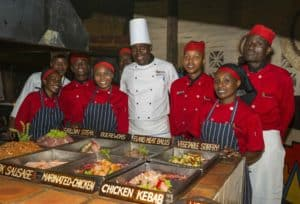 Image 2 - Head chef Brighton Nekatambe (centre) and The Boma - Dinner Drum Show culinary team